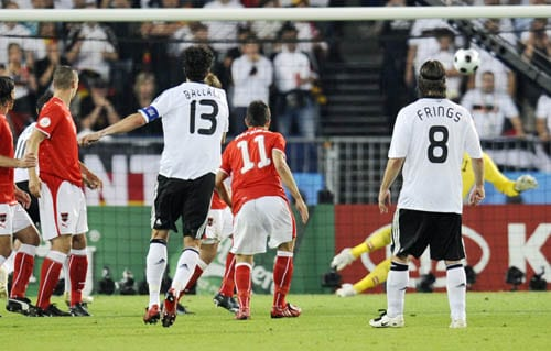 Germany's Michael Ballack, 13, scores the opening goal after shooting a free kick during the group B match between Austria and Germany in Vienna, Austria.