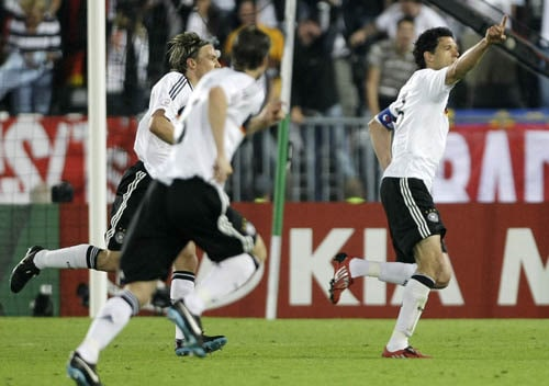Germany's Michael Ballack, right, celebrates scoring the opening goal during the group B match between Austria and Germany in Vienna, Austria.
