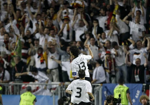 Germany's Michael Ballack, rear, followed by teammate Arne Friedrich, celebrates scoring the opening goal during the group B match between Austria and Germany in Vienna, Austria.