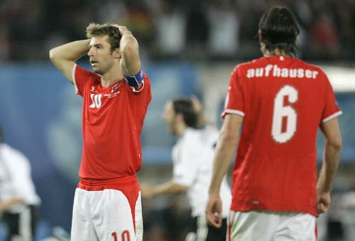 Austria's Andreas Ivanschitz, left, and Rene Aufhauser react during the group B match between Austria and Germany in Vienna, Austria.