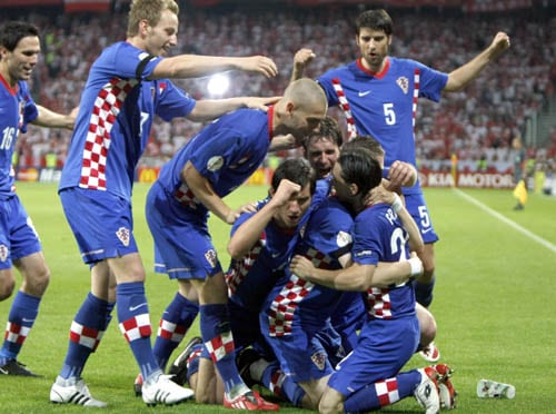 Croatia's Ivan Klasic, second from right at bottom, celebrates with fellow team members after scoring during the group B match between Poland and Croatia in Klagenfurt, Austria.