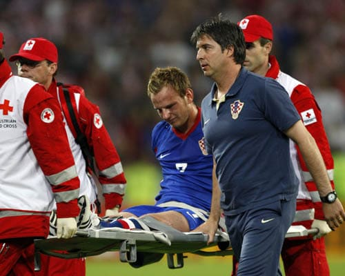 Croatia's Ivan Rakitic is carried off the pitch during the group B match between Poland and Croatia in Klagenfurt, Austria.