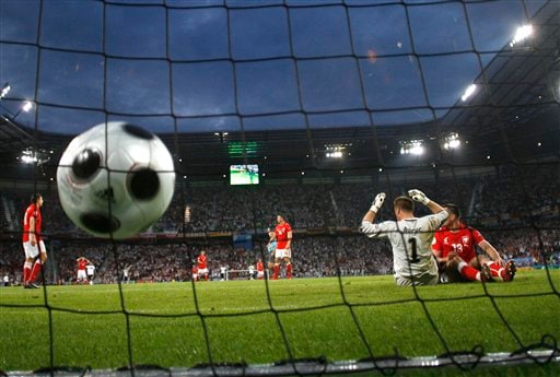 Poland's goalkeeper Artur Boruc reacts after Germany's Lukas Podolski, unseen, scored the opening goal during the group B match between Germany and Poland in Klagenfurt, Austria.