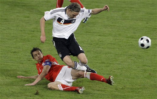 Germany's Clemens Fritz, top, is tackled by Poland's Jacek Bak, bottom, during the group B match between Germany and Poland in Klagenfurt, Austria.