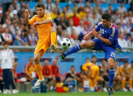 Romania's Adrian Mutu, left, and France's Jeremy Toulalan fight for possession for the ball during the group C match between Romania and France in Zurich, Switzerland.