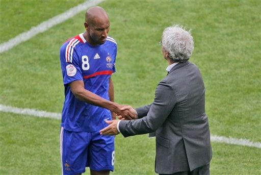 France's Nicolas Anelka shakes hand with France's head coach Raymond Domenech after being substituted during the group C match between Romania and France in Zurich, Switzerland.