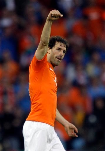 Netherlands' Ruud van Nistelrooy celebrates after scoring during the group C match between the Netherlands and Italy in Bern, Switzerland.