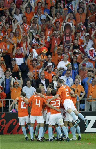 Dutch players celebrate scoring the opening goal by Ruud Van Nistelrooy during the group C match between the Netherlands and Italy in Bern, Switzerland.