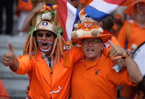 Dutch supporters cheer as they wait for the start of the group C match between the Netherlands and Italy in Bern, Switzerland.
