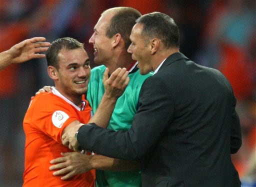Netherlands' Wesley Sneijder, left, celebrates with coach Marco Van Basten, right, after scoring during the group C match between the Netherlands and Italy at the Stade de Suisse in Bern, Switzerland.