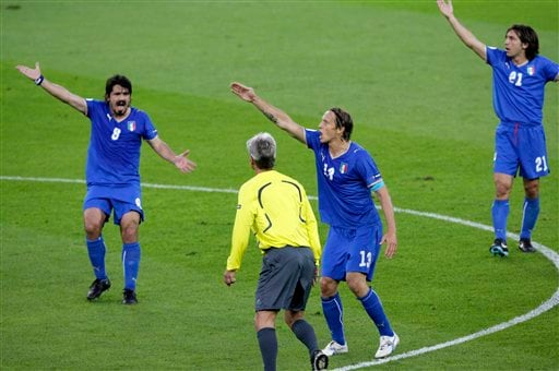 Italy's Gennaro Gattuso, left, Massimo Ambrosini, second left, and Andrea Pirlo, right, argue with referee Peter Frojdfeldt from Sweden after Netherlands scored the opening goal during the group C match between the Netherlands and Italy in Bern, Switzerland.