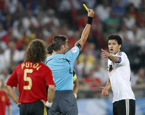 Germany's Michael Ballack, right, receives a yellow card by Italian referee Roberto Rosetti during the Euro 2008 final between Germany and Spain in the Ernst-Happel stadium in Vienna.