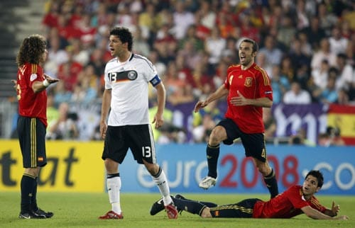 Germany's Michael Ballack, second from left, faces Spain's Carles Puyol during the Euro 2008 final between Germany and Spain in the Ernst-Happel stadium in Vienna.