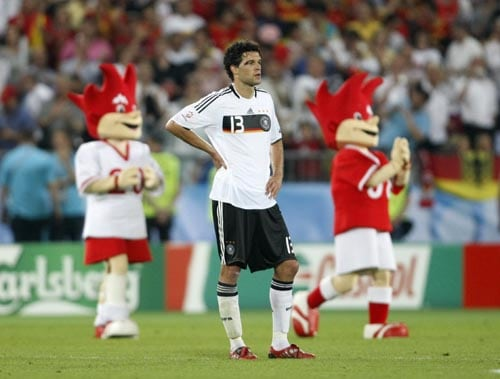 Germany's Michael Ballack reacts in front of the mascots Trix and Flix after losing the Euro 2008 final between Germany and Spain in the Ernst-Happel stadium in Vienna.