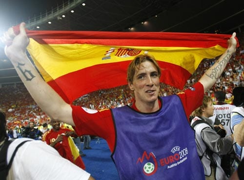 Spain's Fernando Torres celebrates with the Spanish flag after winning the Euro 2008 final between Germany and Spain in the Ernst-Happel stadium in Vienna.