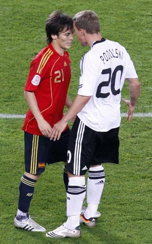 Spain's David Silva, left, faces Germany's Lukas Podolski during the Euro 2008 final between Germany and Spain in the Ernst-Happel stadium in Vienna.