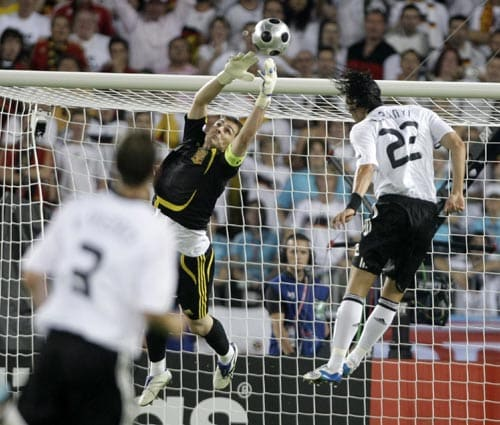 Spain's Iker Casillas deflects a header by Germany's Kevin Kuranyi, right, during the Euro 2008 final between Germany and Spain in the Ernst-Happel stadium in Vienna.