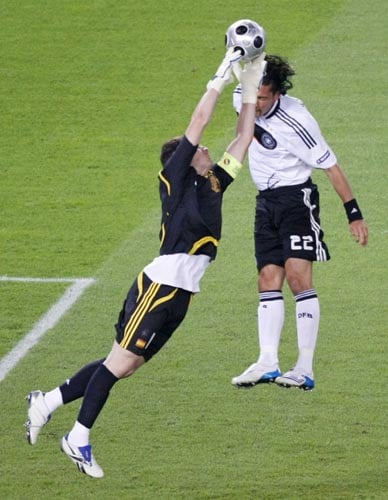 Spain's Iker Casillas, left, makes a save ahead of Germany's Kevin Kuranyi during the Euro 2008 final between Germany and Spain in the Ernst-Happel stadium in Vienna.