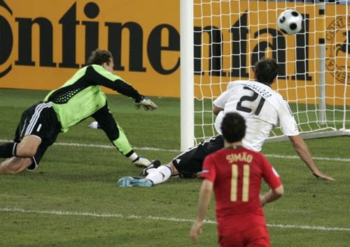 Portugal's Nuno Gomes, unseen, scores his side's first goal past Germany's Jens Lehmann, left, and Christoph Metzelder during the quarterfinal match between Portugal and Germany in Basel, Switzerland.