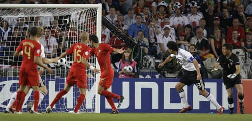 Germany's Michael Ballack, second from right, scores his side's third goal during the quarterfinal match between Portugal and Germany in Basel, Switzerland.