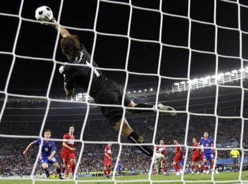 Turkey's goalie Rustu Recber dives for a save during the quarterfinal match between Croatia and Turkey in Vienna, Austria.