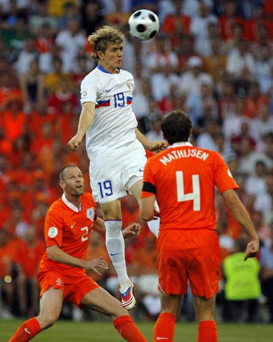 Russia's Roman Pavlyuchenko, center, Netherlands Joris Mathijsen, right, and Andre Ooijer, left, fight for the ball during the quarterfinal match between the Netherlands and Russia in Basel, Switzerland.