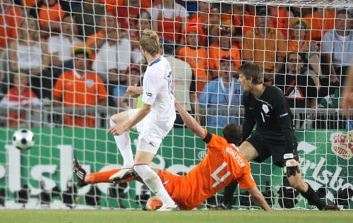 Russia's Roman Pavlyuchenko, left, scores the opening goal during the quarterfinal match between the Netherlands and Russia in Basel, Switzerland.