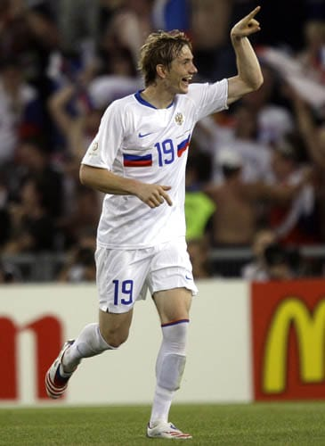Russia's Roman Pavlyuchenko celebrates after scoring the opening goal during the quarterfinal match between the Netherlands and Russia in Basel, Switzerland.