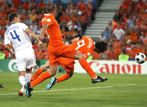 Netherlands' Ruud van Nistelrooy, right, scores on a header during the quarterfinal match between the Netherlands and Russia in Basel, Switzerland.