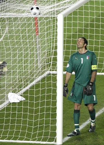 Italy's Gianluigi Buffon looks at the ball that fell over his net during the quarterfinal match between Spain and Italy in Vienna, Austria.