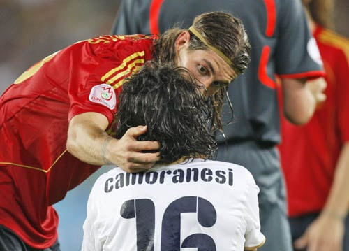 Spain's Sergio Ramos, left, talks to Italy's Mauro Camoranesi during the quarterfinal match between Spain and Italy in Vienna, Austria.