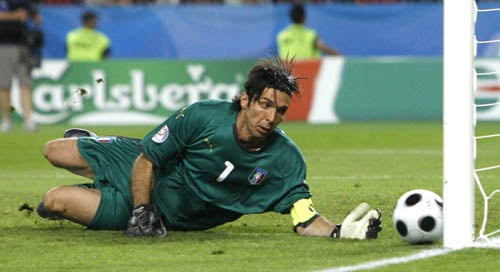 Italy's Gianluigi Buffon reaches for the ball during the quarterfinal match between Spain and Italy in Vienna, Austria.