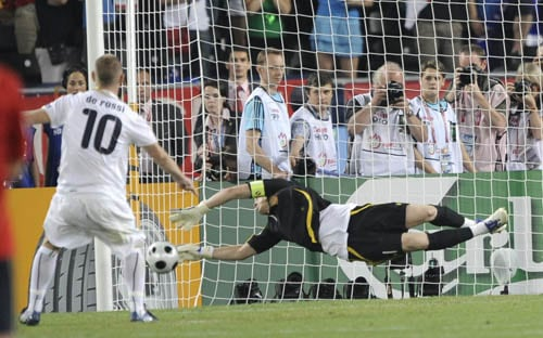 Spain's Iker Casillas, right, saves a penalty kicked by Italy's Daniele De Rossi, left, during the penalty shootout in the quarterfinal match between Spain and Italy in Vienna, Austria.