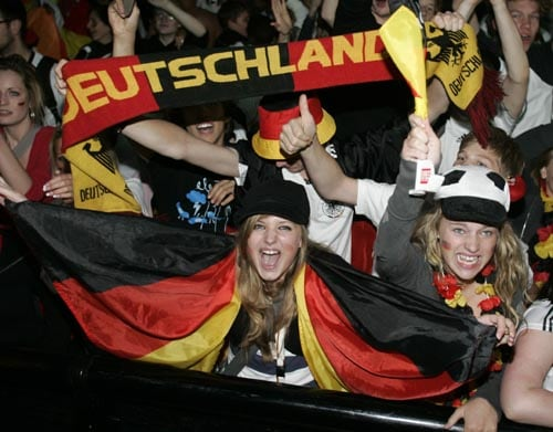 Germany's fans celebrate at the KoelnArena-Dome after Germany scored the second goal during the soccer Euro 2008 semi-final match between Germany and Turkey, in Cologne, western Germany.