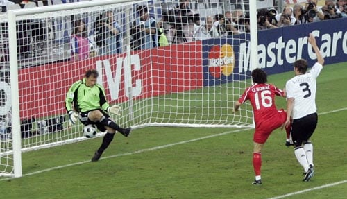 Turkey's Ugur Boral, second right, scores the opening goal past German goalie Jens Lehmann, left, during the semifinal match between Germany and Turkey in Basel, Switzerland.