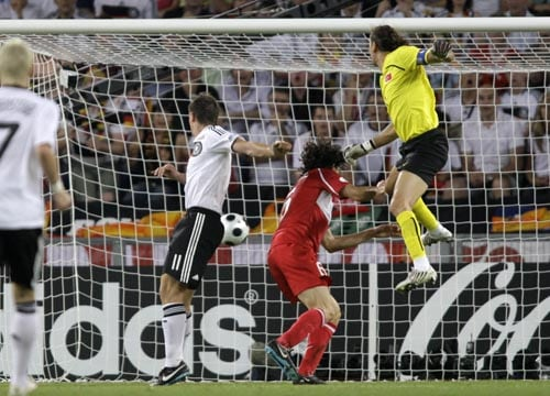 Germany's Miroslav Klose, second left, scores his side's second goal past Turkey's Rustu Recber, right,during the semifinal match between Germany and Turkey in Basel, Switzerland.