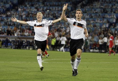 Germany's Miroslav Klose, right, celebrates with Germany's Bastian Schweinsteiger after scoring his side's second goal during the semifinal match between Germany and Turkey in Basel, Switzerland.