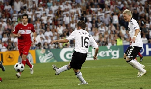 Germany's Philipp Lahm scores his side's third goal during the semifinal match between Germany and Turkey in Basel, Switzerland.