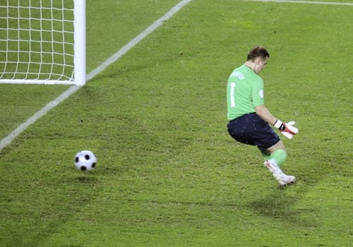 Russia's Igor Akinfeev fails to make a save as Spain's Xavi Hernandez, unseen, scores the opening goal during the semifinal match between Russia and Spain in Vienna, Austria.