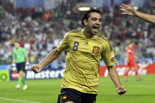 Spain's Xavi Hernandez celebrates after scoring his side's opening goal during the semifinal match between Russia and Spain in Vienna, Austria.