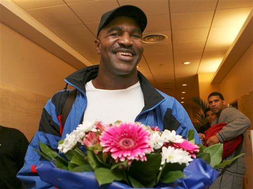 Heavyweight champion boxing Evander Holyfield arrives in Moscow, Sunday, Oct. 7, 2007. Holyfield is jumping back into the ring Oct. 13 to fight Sultan Ibragimov at Moscow's Khodynka Ice Palace arena, part of his quest to retire as the oldest heavyweight champion.
