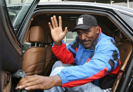 Heavyweight boxing champion Evander Holyfield arrives in Moscow, Sunday, Oct. 7, 2007. Holyfield is jumping back into the ring Oct. 13 to fight Sultan Ibragimov at Moscow's Khodynka Ice Palace arena, part of his quest to retire as the oldest heavyweight champion.