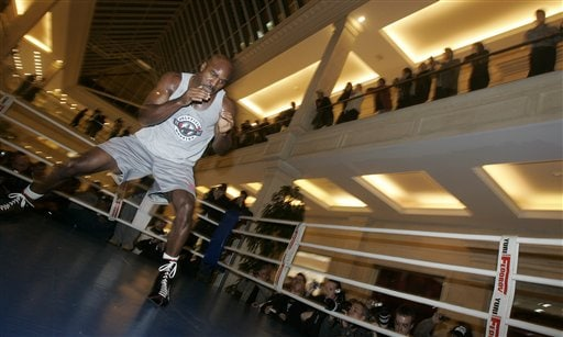 Former heavyweight boxing champion Evander Holyfield is seen in action during his open training session in Moscow, Monday, Oct. 8, 2007. Holyfield is jumping back into the ring Oct. 13 to fight Russia's Sultan Ibragimov at Moscow's Khodynka Ice Palace arena, part of his quest to retire as the oldest heavyweight champion.