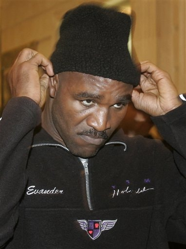 Former heavyweight boxing champion Evander Holyfield adjusts his hat going out after his open training session in Moscow, Monday, Oct. 8, 2007. Holyfield is jumping back into the ring Oct. 13 to fight Russia's Sultan Ibragimov at Moscow's Khodynka Ice Palace arena, part of his quest to retire as the oldest heavyweight champion.