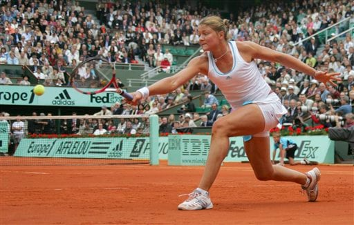 Dinara Safina stretches to make a return to Ana Ivanovic at the French Open final.