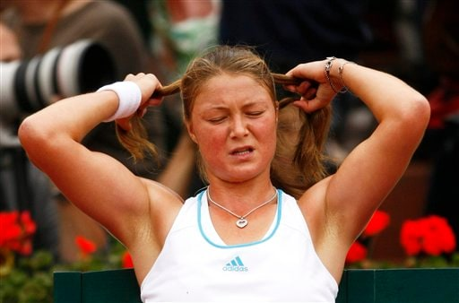 Dinara Safina adjusts her hair during her match against Ana Ivanovic at the French Open final.