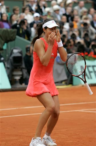 Ana Ivanovic drops her racquet after winning the French Open 2008.