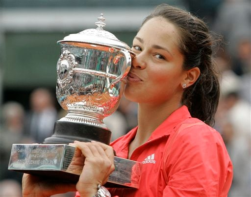 Ana Ivanovic kisses the winner's trophy after beating Dinara Safina at the French Open final in Paris.