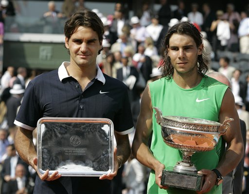 Federer and Nadal pose with their trophies. (AP)