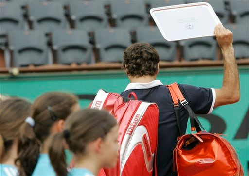 Roger Federer walks off the court after receiving the runners up trophy. (AP)